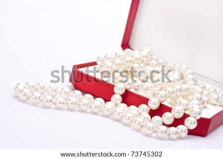 pearls in a red gift box - stock photo