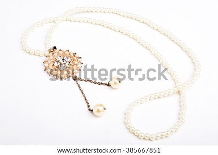 Pearls necklace on white background - stock photo