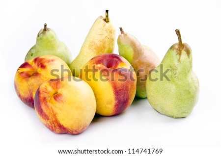 Pears and apples on white