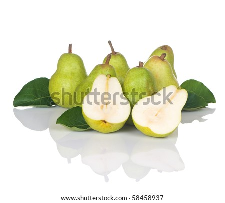 Pears and leaves in a grouping with one sliced in half - stock photo