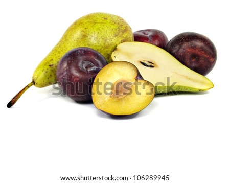pears and plums on a white background - stock photo
