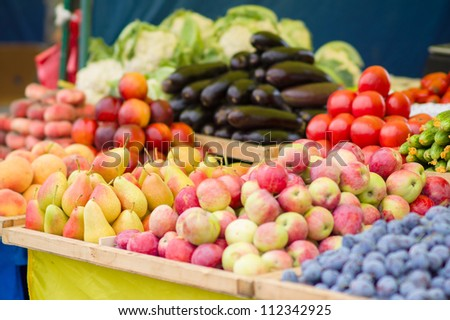 Pears, apples, plums, cucumbers, tomatoes, eggplants in city market