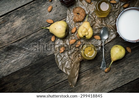 pears Cookies and yoghurt on wooden table. Rustic style and autumn food photo - stock photo