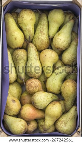 Pears in wooden crate for sale  at a street market. Background. - stock photo