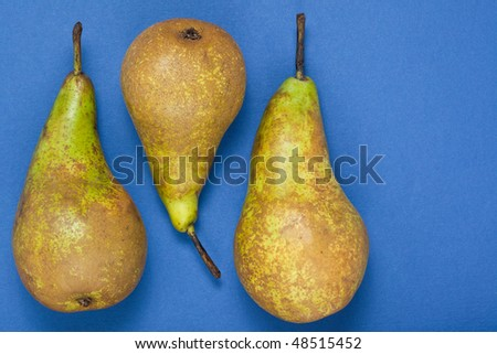 Pears on a blue background with room for text to the right hand side