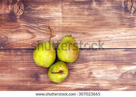 Pears on a wooden background - stock photo