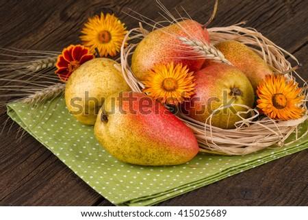 pears on green napkin decoration fall still life - stock photo