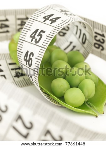 peas and measuring tape, diet concept