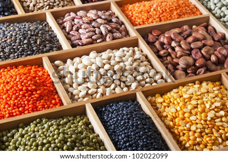 peas, beans and lentils in the wooden box