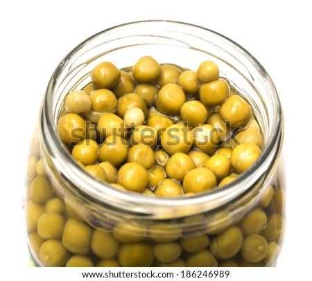 peas in a pot on white background - stock photo