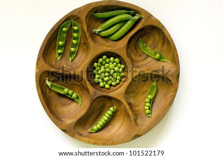 Peas in vintage wooden bowl - stock photo