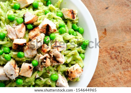 peas pesto with fusilli and diced grilled chicken, a delicious healthy meal - stock photo