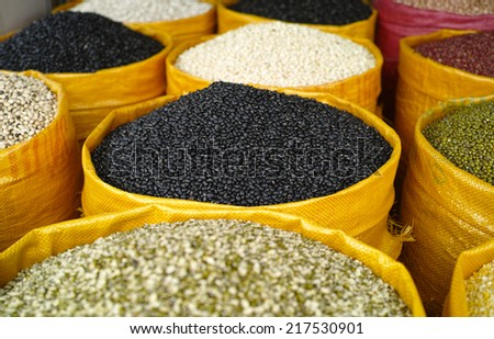 Peas,Rices, beans and lentils in bags sell in the market - stock photo