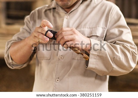 Peasant cutting a traditional cigar in Cuba - stock photo