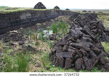 Peat bogs and dug up peat piles for home fires, Achill Island, County mayo, Ireland. - stock photo