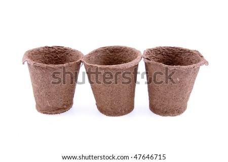 Peat pots isolated on a white background - stock photo
