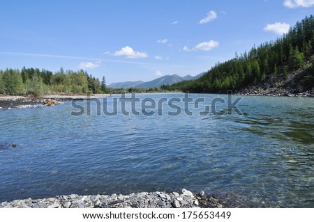Pebble Bank of a mountain river. Russia, Yakutia, A Ridge Of Suntar-Khayata.