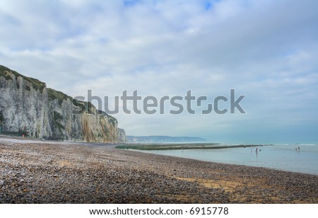 Pebble beach and shoreline at the Alabaster Coast in Dieppe, France. HDR-processed image. - stock photo