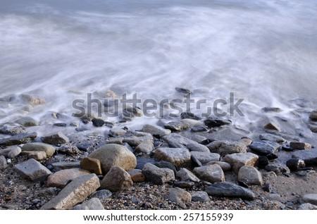 Pebble Beach Ocean Water Long Exposure  - stock photo