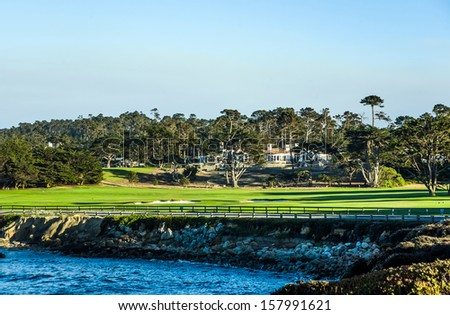 PEBBLE BEACH, USA - JULY 27: beautiful houses at the Pebble Beach Golf Course in Pebble Beach on July 27, 2013. Pebble Beach is part of the famous 17 miles drive area. - stock photo