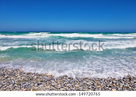 Pebble beach with ocean (Cape Province - South Africa) - stock photo