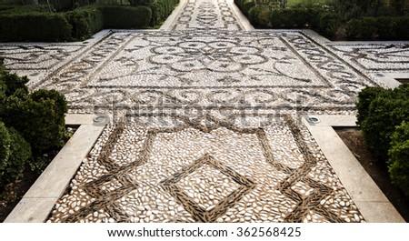 Pebble mosaic at the Medina garden in The Alhambra, Granada, Spain - stock photo