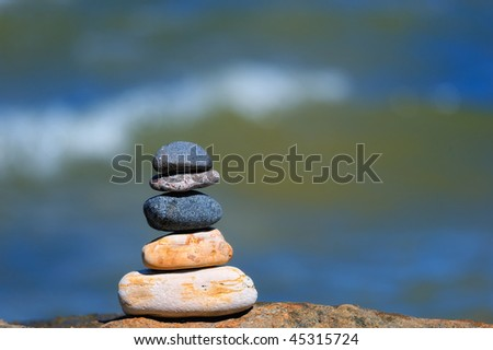 Pebble of the sea on the background of water