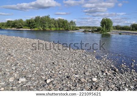 Pebble river banks. Polar Ural, Komi Republic, Russia. - stock photo
