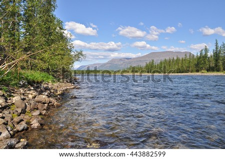 Pebble river Nakta on the Putorana plateau. Water summer landscape of the Siberian mountains. - stock photo