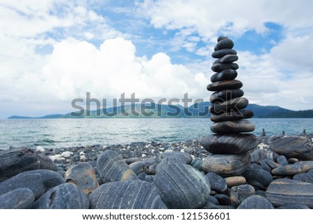 Pebble stack on the pebble beach - stock photo