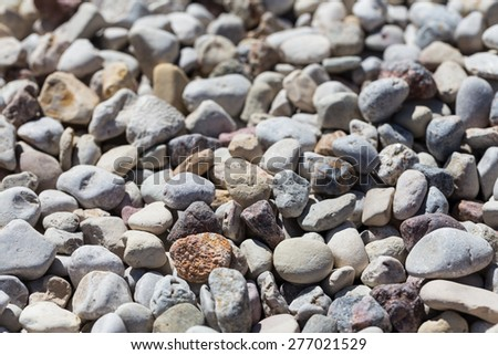 pebble stones background. closeup of stones texture - stock photo