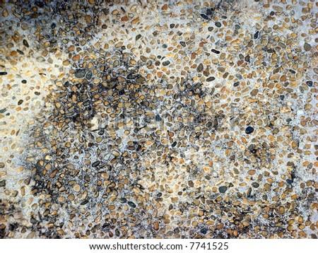 Pebble stones texture on wall - stock photo