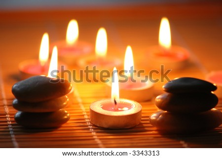 Pebbles and candles for the  aromatherapy session - stock photo