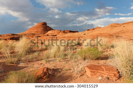 Pebbles and Flowing Rock near Lake Powell, Glen Canyon National Recreational Area, Page, Arizona, USA.