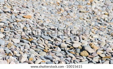 Pebbles from shingle beach, suitable for background or texture - stock photo