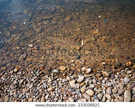 Pebbles in a stream , Pebbles under water - stock photo