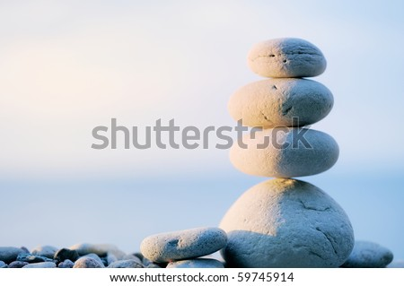 Pebbles in balancing on the sea coast - stock photo