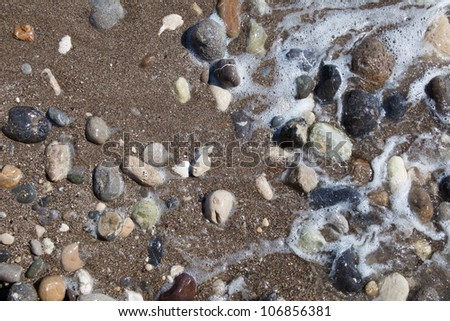 pebbles in the sand - stock photo