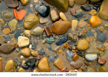 pebbles pattern in a pool of sea water on the beach