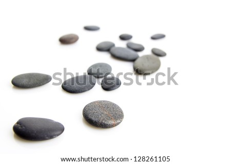 pebbles scattered over white background - stock photo