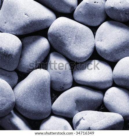 Pebbles stones as a background. Moonlight effect.