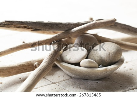 pebbles with drift wood for mineral spa treatment - stock photo