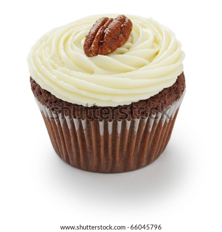 Pecan nuts chocolate cupcake on white background - stock photo