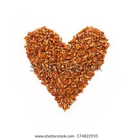 Pecan nuts in heart shape on white background