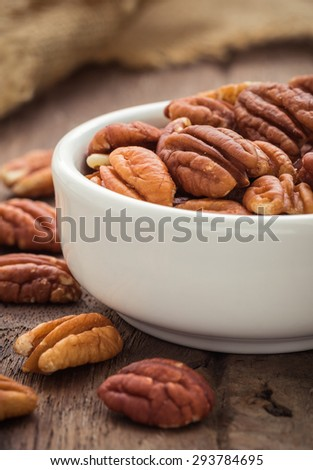 Pecan nuts in white bowl - stock photo