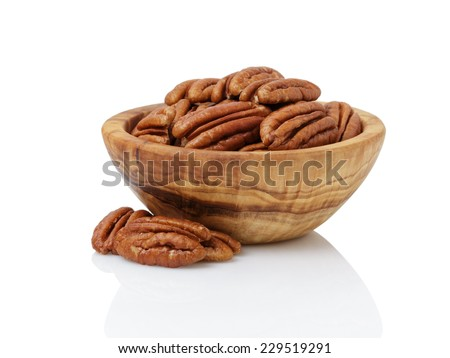 pecan nuts in wood bowl, isolated on white background - stock photo
