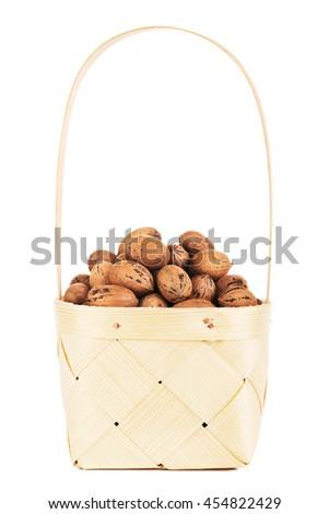 Pecan Nuts In Wooden Basket - stock photo