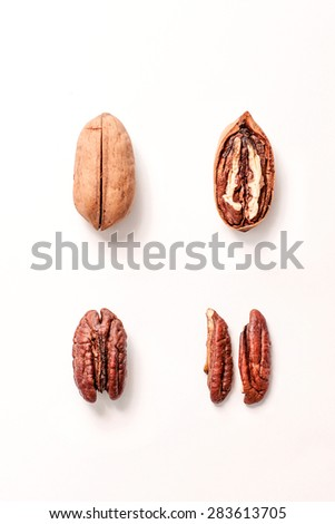 Pecan nuts on white background - stock photo