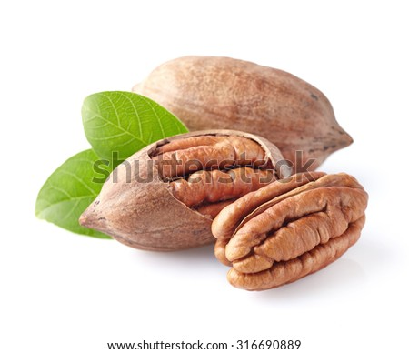 Pecan nuts with leaves - stock photo
