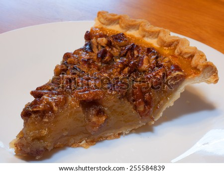 Pecan pie that has just been sliced and put on a plate - stock photo